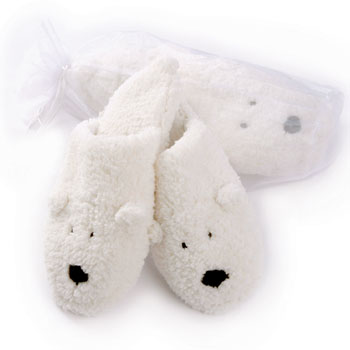 Give your feet some soothing relief with our Heated Herbal Polar Bear